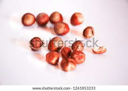 Hazel nuts whole and cracked opened isolated on white with a close-up #1261853233