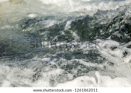 Sea waves beat on the shore as a background #1261862011