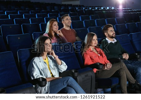 Young people watching movie in cinema theatre #1261921522