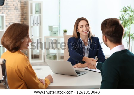 Human resources manager conducting job interview with applicants in office #1261950043