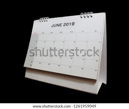 Desktop calendar of June 2019 isolated on black background. #1261959049