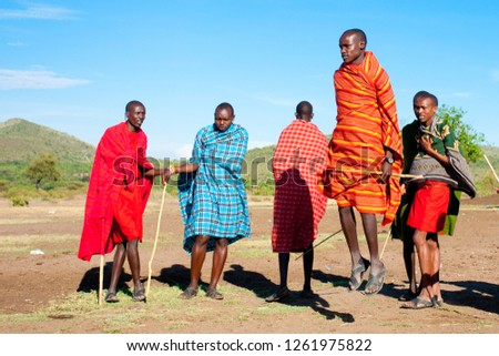 Unidentified Maasai men on Oct 15, 2012 in the Maasai Mara, Kenya. Maasai are a Nilotic ethnic group of semi-nomadic people located in Kenya and northern Tanzania. #1261975822