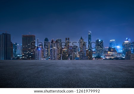 Bangkok urban cityscape skyline night scene with empty asphalt floor on front #1261979992