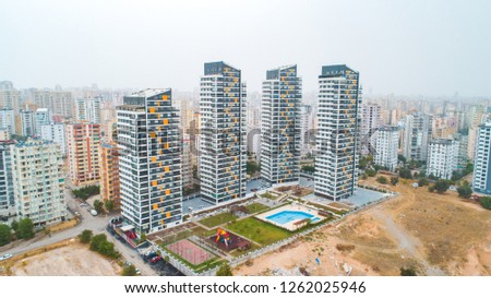 New multi-storey residential building apartment houses aerial view with swimming pool, basketball court and children playground. Mortgage background concept image. #1262025946