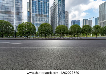 Panoramic skyline and modern business office buildings with empty road,empty concrete square floor #1262077690