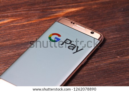 Kazan, Russian Federation - Aug 5, 2018: hand holding a brand new Samsung Galaxy S7 mobile phone which displays the Android Pay app on the touch screen #1262078890