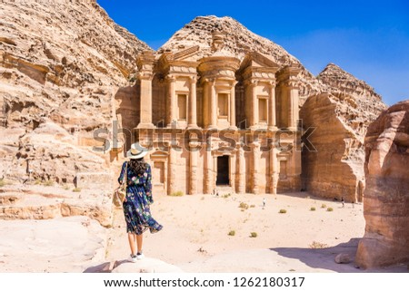 Asian young woman in colorful dress and hat enjoying at The Monastery, Petra's largest monument, UNESCO World Heritage Site, Jordan. #1262180317