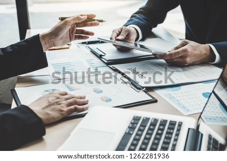 Finance manager meeting discussing company growth project success financial statistics, professional investor working start up project for strategy plan with document, laptop and digital tablet. #1262281936