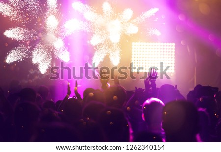 New Year concept - fireworks and cheering crowd celebrating the New Year #1262340154