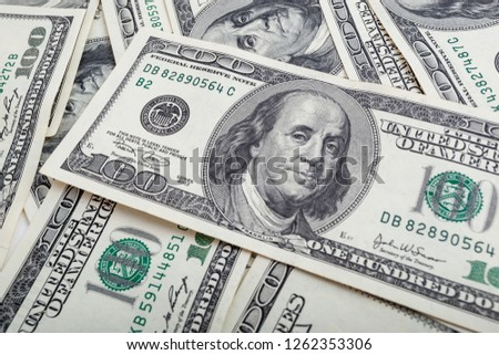 Texture US dollars. Background of one hundred dollar bills. Royalty-Free Stock Photo #1262353306