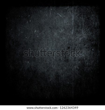 Dark blue scratched scary grunge background, old film effect, distressed texture with black frame, space for your text or picture