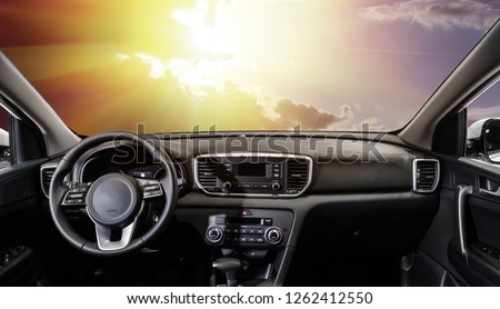 sunset from the interior of a modern car #1262412550