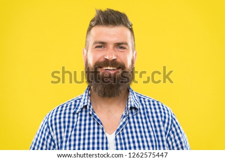Bearded and happy. Man bearded rustic hipster stylish beard yellow background. Barber tips maintain beard. Stylish beard and mustache care. Hipster appearance. Beard fashion and barber concept. #1262575447