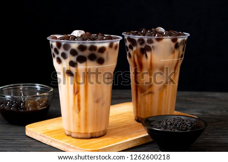 Taiwan milk tea with bubble on wood background