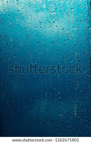 Water drops on window glass #1262671801
