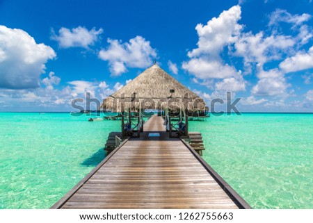 Water Villas (Bungalows) and wooden bridge at Tropical beach in the Maldives at summer day #1262755663