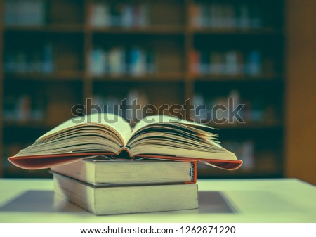 Stack of books in the library #1262871220
