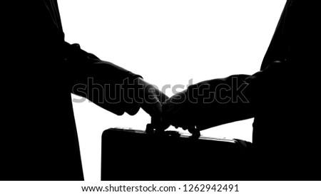 Businessman giving suitcase to partner, underground economy, illegal deal, bribe #1262942491