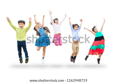 happy kids jumping in air over white background #1262948719