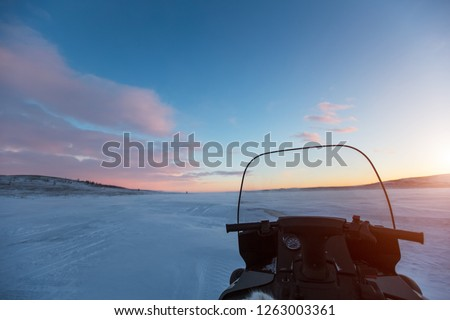 All-terrain vehicle at sunset in desert of snowy Siberia. #1263003361
