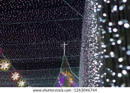 Chrismas Festival ,Light of star,light of Church,lamp of star,light of star,Tunnel of light,Star Wall in the night,Christmas light,at Ban Tha Rae,Sakon Nakhon,Thailand. #1263046744