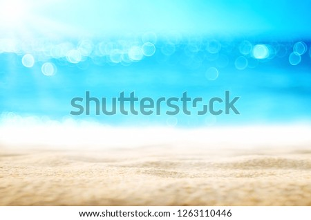 Blur tropical beach with bokeh sun light wave abstract background. Copy space of outdoor summer vacation and travel adventure concept. Vintage tone filter effect color style. #1263110446