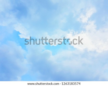 Image of clear sky on day time. blue sky with cloud. Picture shows a bright, lonely, sad mood, sometimes emotional high, floating can not be tangible. Blue tone for decoration wedding invitation card.