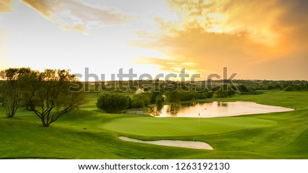 Panoramic view of water hazards on a fairway golf course #1263192130