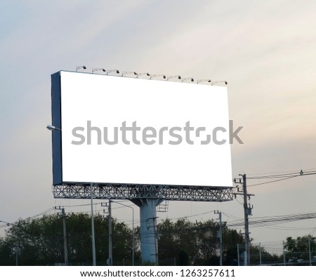 Blank billboard on blue sky background for new advertisement #1263257611