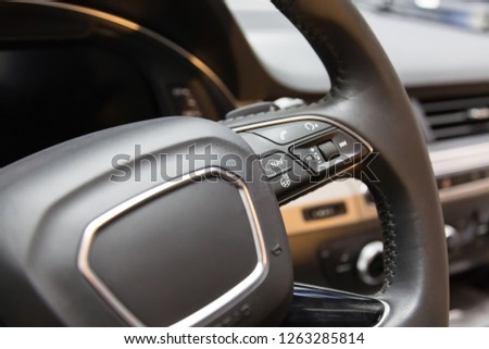 Heated steering wheel. The buttons on the steering wheel. call answer and navigation button. #1263285814