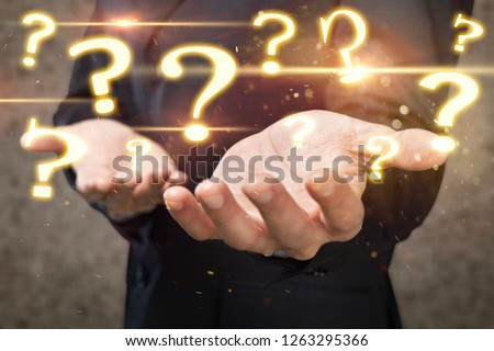 Question Marks with businessman on dark vintage background #1263295366
