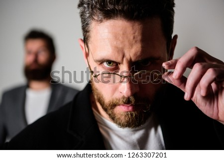 Smart glance. Accessory for smart appearance. Now i see everything. Attentive glance. Picky smart inspector. Man handsome bearded guy wear eyeglasses. Eye health and sight. Optics and vision concept. Royalty-Free Stock Photo #1263307201