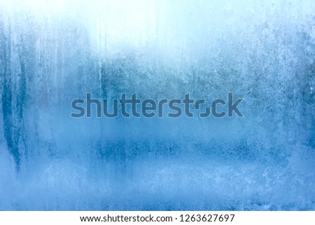 Blue Frost Background, Closeup Frozen Winter Window Pane Coated Shiny Icy Frost Patterns, Extreme North Low Temperature, Natural Ice Pattern on a Frosty Glass #1263627697
