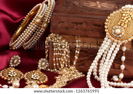 Vintage wooden jewellery box with Indian traditional jewelry, pearl earrings, pearl bracelet Luxury female jewelry, Indian traditional jewellery,Bridal Gold wedding jewellery, pearl jewelry #1263761995