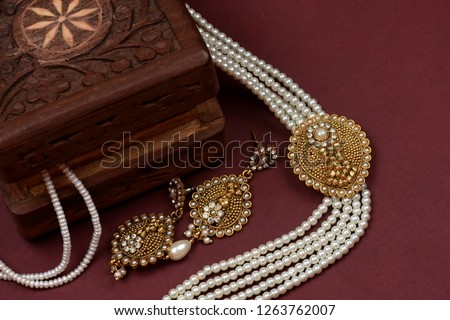 Vintage wooden jewellery box with Indian traditional jewelry, pearl earrings, pearl bracelet Luxury female jewelry, Indian traditional jewellery,Bridal Gold wedding jewellery, pearl jewelry #1263762007