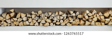 wall firewood, Background of dry chopped firewood logs in a pile. panorama