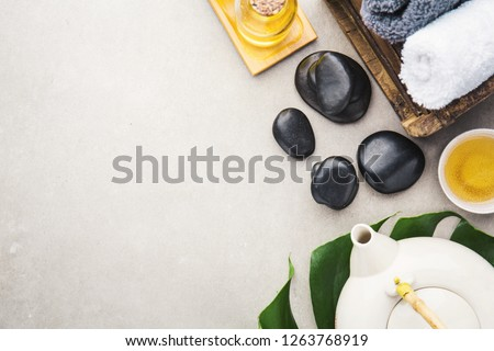 Spa Wellness Relax concept. Spa background with spa accessories on grey background. View from above with copy space.  #1263768919