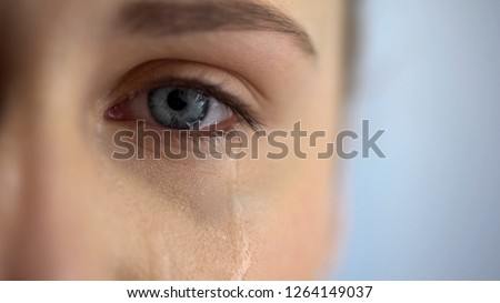 Sad woman crying, suffering pain eyes full of tears, domestic violence victim #1264149037