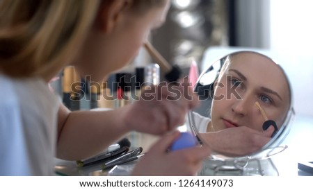 Lady skillfully applying face foundation, morning makeup, facial skin care #1264149073