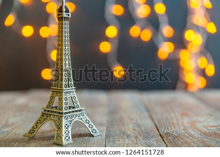 figure of the Eiffel tower on the background of a glowing garland #1264151728