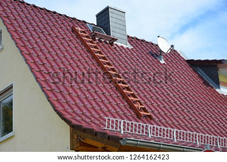 Tiled Roof of a Residential Building Snow Guard and Eves Gutter #1264162423