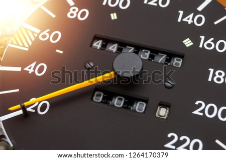 Close up shot of a speedometer in a car. Car dashboard. Dashboard details with indication lamps.Car instrument panel. Dashboard with speedometer, tachometer, odometer. Car detailing. Modern interior Royalty-Free Stock Photo #1264170379