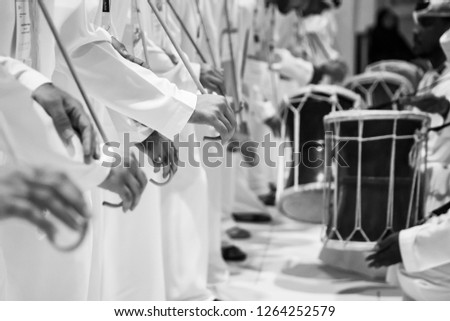 Group of emirati dancing traditional men dance in heritage festival Royalty-Free Stock Photo #1264252579