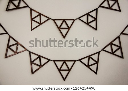 abstract gold triangles on a white wall #1264254490