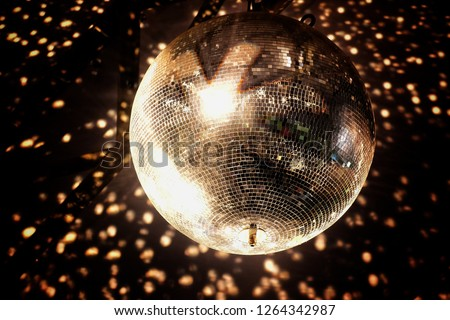 Mirror, disco ball, reflecting colorful lights. #1264342987