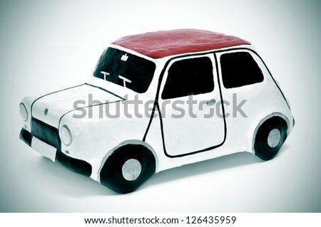 closeup of a papier-mache toy car #126435959