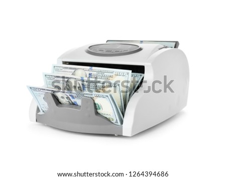 Modern electronic bill counter with money on white background Royalty-Free Stock Photo #1264394686