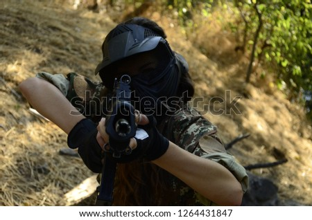 Airsoft game beautiful Girl With Gun. in forest  #1264431847