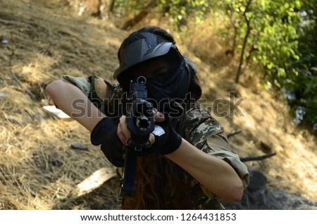 Airsoft game beautiful Girl With Gun. in forest  #1264431853