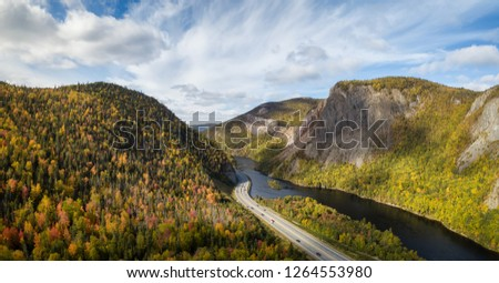 Aerial panoramic view of a scenic road during a vibrant sunny day. Taken near Corner Brook, Newfoundland, Canada. #1264553980